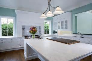 open space kitchen with white quartz countertops home