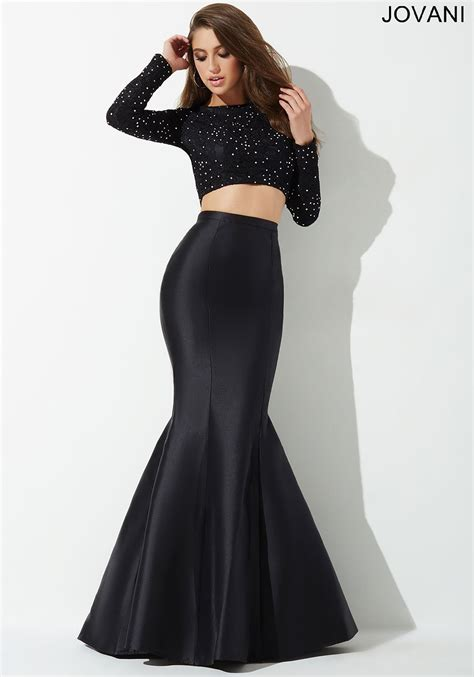 Jovani Style 26336 Gorgeous two piece prom dress features a crystal embellished long sleeve top