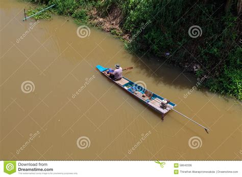 row your boat fish fisherman rowing row boat to catch fish on river stock