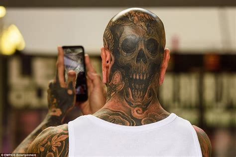 flash tattoo in london revellers attend international london tattoo convention