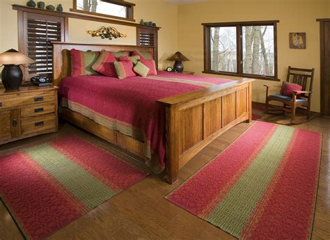 where to place a rug in a bedroom how to use rugs in the bedroom