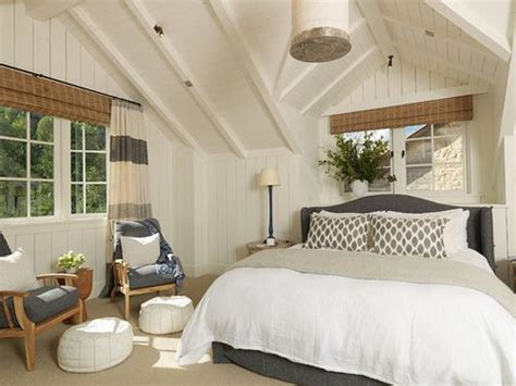 bedrooms gray tongue and groove walls gray drapes framing bed charcoal gray tufted linen bed grey and white bedroom warmed up with wood tones nice