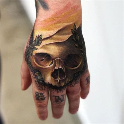 Tattoo Goo Melbourne | sick skull tattoo on the hand by mick squires australian