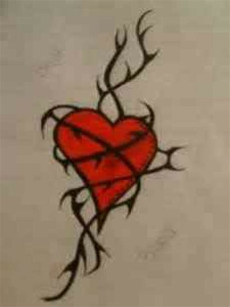heart rose and vine tattoo designs entwined in thorns inked
