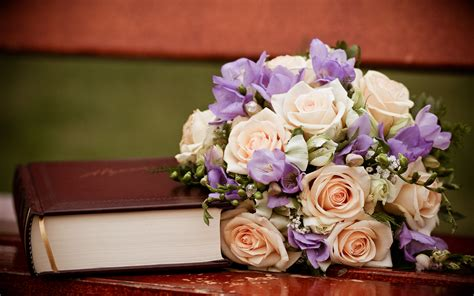 flower books a bouquet of flower next to a thick book book is thus