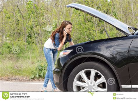 woman driver on the phone for car breakdown female driver phoning for help after a breakdown stock