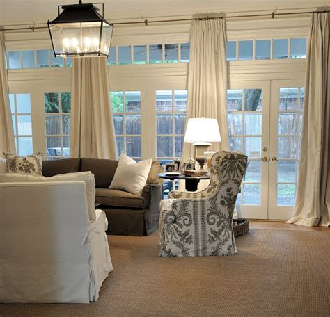 wall of windows curtains french doors and transom windows transitional living