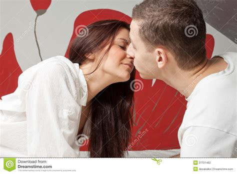 women kissing in bed man and woman kissing in the bed stock photography image 27721482