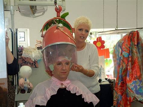 sissy boys hair dryers sissy at the salon under the dryer in his pretty pink