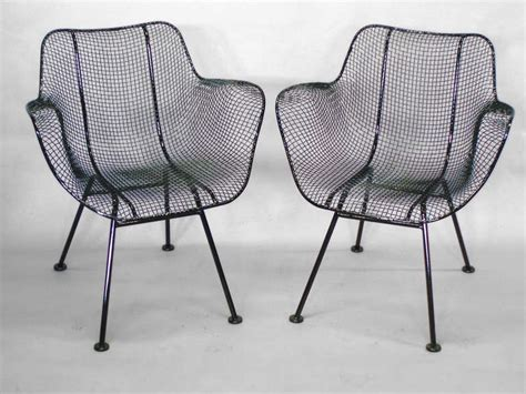 six wrought iron with mesh dining chairs by