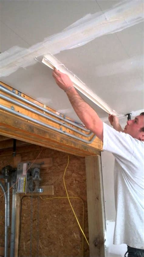 how to drywall a ceiling how to mud and drywall ceilings step 1 applying taping helpful home tips