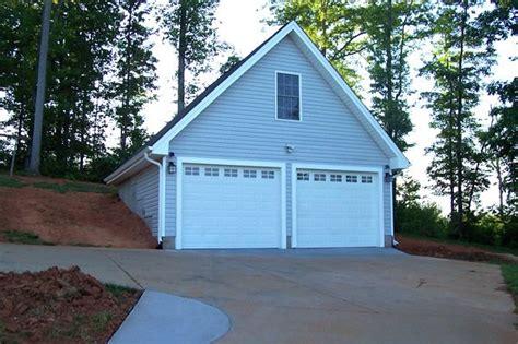 hillside garage plans 2 car garage with bonus room built into a hillside our