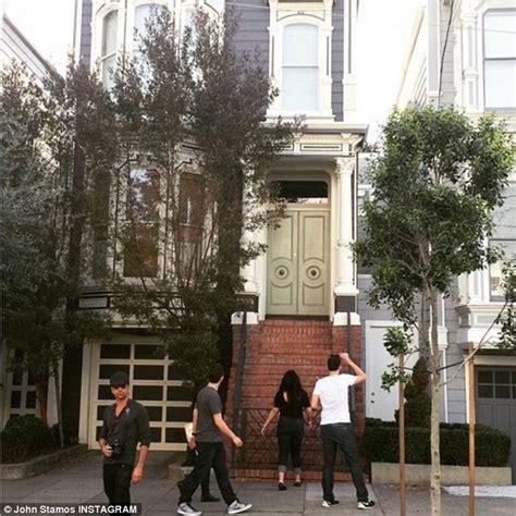 stamos pranks house fans by posing next to them