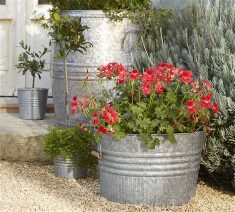 Large Galvanized Planters by 10 Easy Pieces Zinc Barrel Planters Yahoo Homes