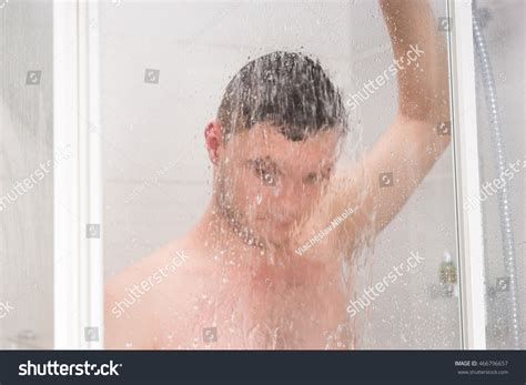 Shower While by Taking Shower Holding Shower Stock Photo