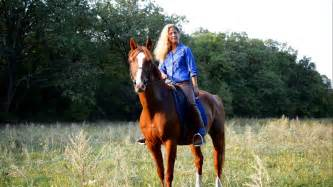 commercial girl riding horse young blonde girl riding a horse stock footage video