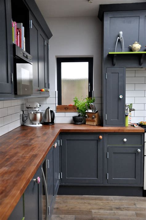 black and wood kitchen cabinets wooden counters can not only look very chic but will also