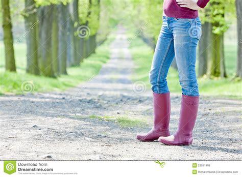 wearing rubber boots wearing rubber boots royalty free stock photos