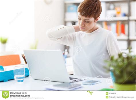 back pain from sitting at desk office worker with neck pain stock photo image 67308808