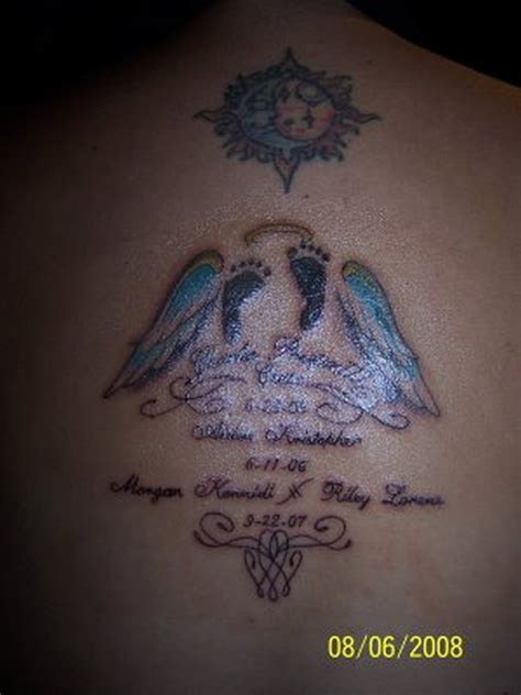 glowing footprints n angel wings tattoo design on back