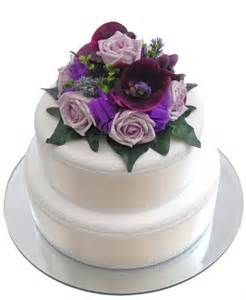 hand made round cake topper in purple and lilac flowers sarah s flowers