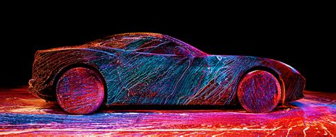 photographer coats a in an explosion of color with uv paint and a wind tunnel