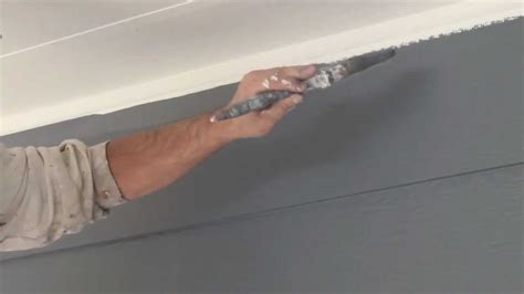 How To Paint Between Ceiling And Wall by How To Cut In Paint Edges And Get A Ceiling Line