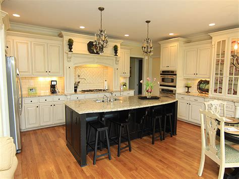 white kitchen cabinets with black island kitchen