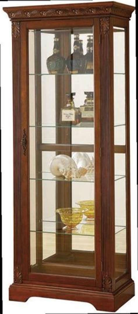 cherry wood curio medallion cherry curio by pulaski furniture