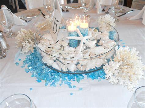 beach wedding inspiration seashell candles centerpiece
