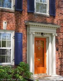 blue house orange door tone on tone storm doors ideas and inspirations