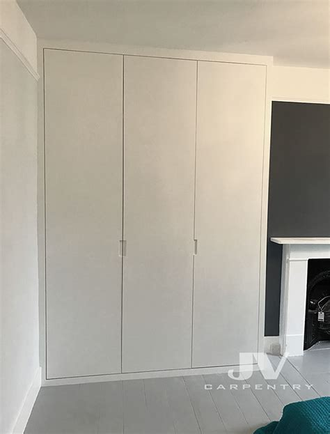 fitted wardrobes bookshelves  alcove cupboards top