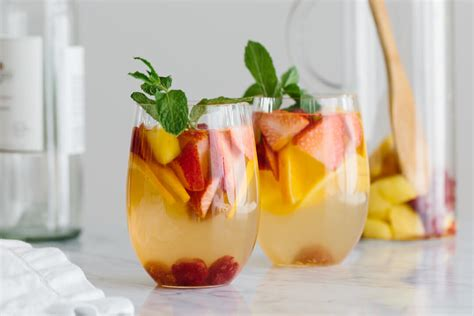 white with white sangria with mango and berries downshiftology