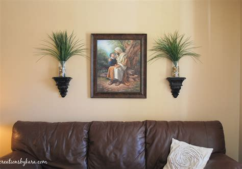 living room wall sconces how to decorate a wall on the cheap