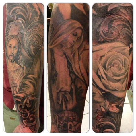 religious rose tattoos touches on this religious half sleeve jesus