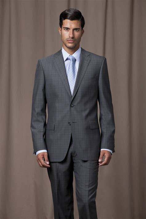 grey checked suit with powder blue shirt and matching