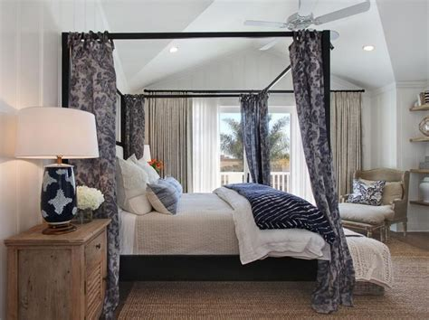 dark blue curtains bedroom gray curtains and a canopy bed give this bedroom a hint of