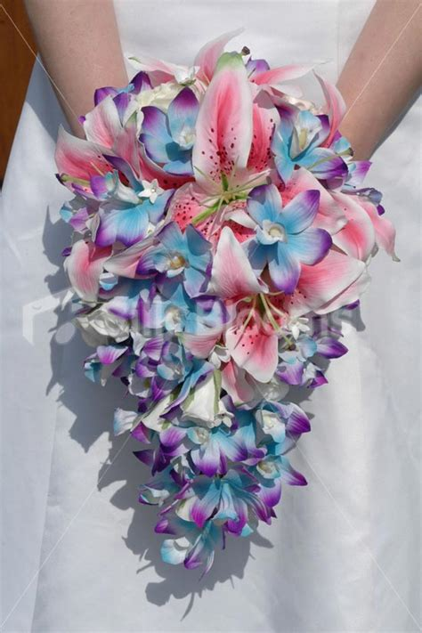 galaxy blue orchid and stargazer lily tropical bridal