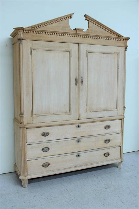 neoclassical linen press cabinet in bleached oak