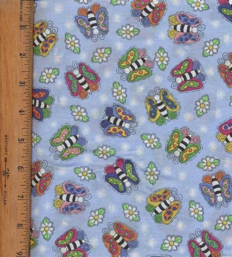 butterflies and on blue fabric quilt fabric 2 yard