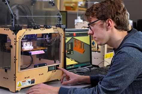 design engineer kent student working with 3d printer