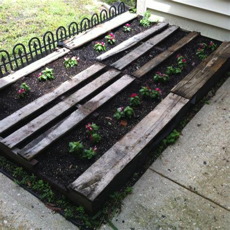 pallet flower bed pallet flower bed whimsical gardens pinterest