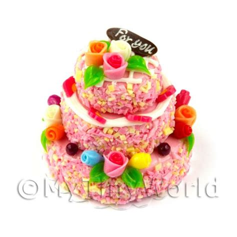 dolls house cakes dolls house miniature cakes and slices miniature 3 tier pink iced celebration cake