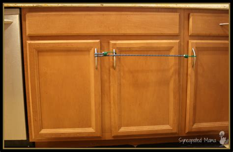 child proof kitchen cabinets syncopated mama how to baby proof with bungee cords