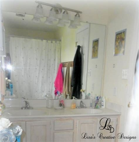 how to dress up a boring bathroom mirror