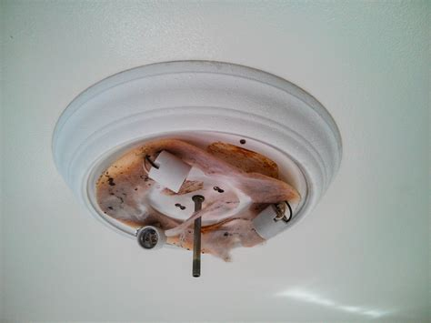 ceiling how can i remove a stuck overhead light fixture