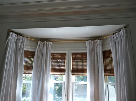 how to hang bay window curtain rods hazardous design let s talk about drapery hardware for