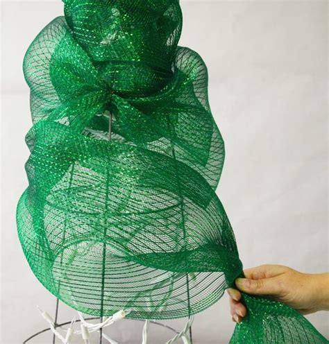 deco mesh christmas tree made with a tomato cage tutorial