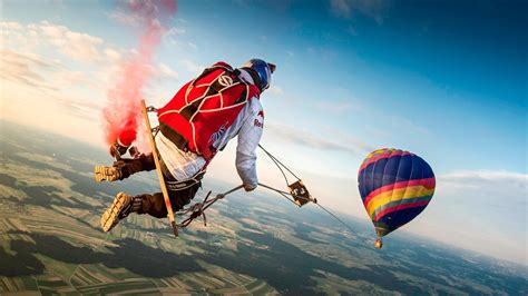 swing air skydivers swinging from hot air balloons is the newest