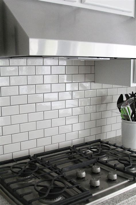 jennifer stagg of with heart chose dark grout when she created a subway tile backsplash in her